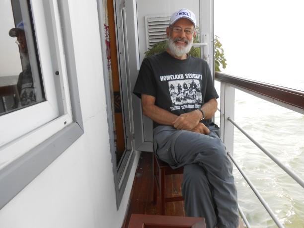Joe on balcony boat