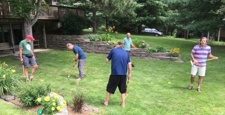 5 men playing croq